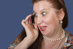 Gossip. There is a woman is telling by mobil phone Royalty Free Stock Images