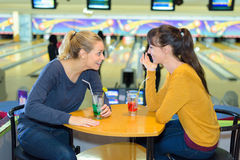 Gossip in bowling center Royalty Free Stock Photography