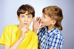 Gossip boys Stock Images