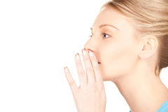Gossip. Bright picture of young woman whispering gossip royalty free stock images