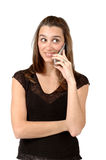 Gossip Cell Phone. Woman gets some news on her cell phone Stock Photo
