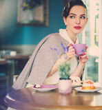 Gossip girl in a cafe.  royalty free stock images