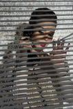 Gossip girl near shutters Stock Photography
