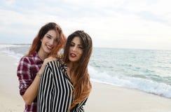 Gossip girls smiling on the beach stock photo