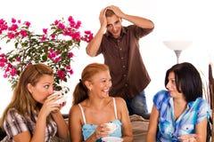 Gossip guy. Three women drink coffee and gossip stock photo