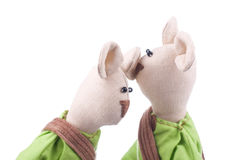 Gossip and rumours. Two whispering toys closeup Stock Photography