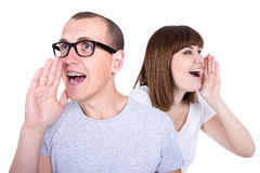 Gossip or sale concept - profile of funny young couple calling s Royalty Free Stock Images