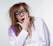 Gossip scientist shaggy woman. On gray background Stock Photography