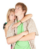 Gossip, teenage girl whispering in boyfriend ear Royalty Free Stock Photo