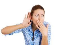 A gossip woman trying to overhear a conversation Royalty Free Stock Images