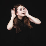 Gossip. Young woman with hands to ear listening Stock Photos