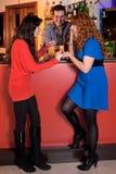 Gossiping At The Bar. Stock Image