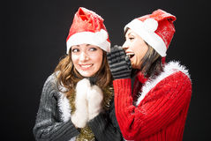 Gossiping Christmas Girls Royalty Free Stock Photos