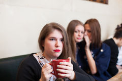 Gossiping a friend in a a cafe Stock Photos