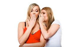 Gossiping friends, two women sharing a secret. Gossip rumour women telling secrets to your girlfriend, secrets spreading over white background stock images