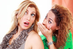 Gossiping girls Stock Photos
