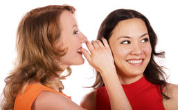 Gossiping girls royalty free stock photography