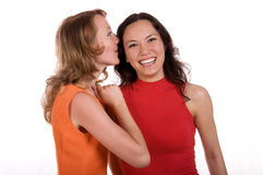 Gossiping girls Royalty Free Stock Image