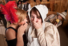Gossiping Ladies with Eavesdropping Cowboy Stock Images