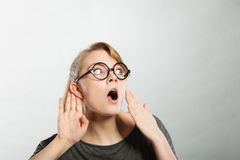 Gossiping shocked girl portrait. Royalty Free Stock Photo