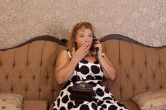Gossiping on telephone Stock Image