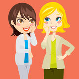 Gossiping Women. Pretty blond and brunette women gossiping friendly Stock Photos