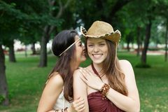 Two happy young girls in summer park stock photography