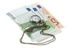 Gotówka i stary kieszeniowy zegarek obraz royalty free