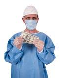 gotówkowego kosztów doktorskiego opieki zdrowotnej pieniądze poważny chirurg Obrazy Royalty Free
