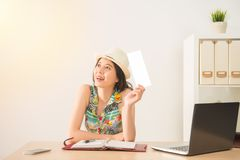She got the air ticket ready to go vacation Royalty Free Stock Photo