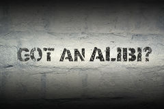 Got an alibi GR. Got an alibi stencil print on the grunge white brick wall Stock Images