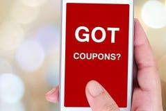 Got coupons? word on smart phone screen, digital marketing Stock Image