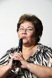 Got gun?. An older Hispanic woman smiling and pointing a gun Stock Photo