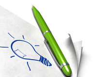 Got an idea. Light bulb written on a white page with a green pen on it Stock Image