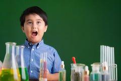 Got idea. Portrait of cute little chemist got an idea Stock Photos