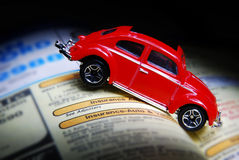 Got Insurance?. A toy car crashed into a phone book stock photos