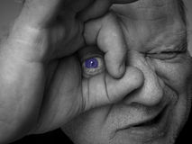 Got my eye on you. Gritty, grungy, holga-like  image of an older man with hands gesturing I've got my eye on you Stock Photo
