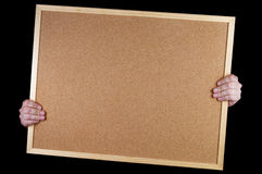 Got notice board. Empty office cork notice board in the hands isolated over black background royalty free stock image
