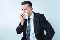 Sick entrepreneur wanting to sneeze Stock Image