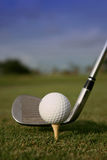Got swing?!?. Close-up of a golf ball on a tee on the green Royalty Free Stock Image