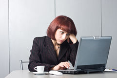 Got tired Beautiful businesswomen behind a desktop Stock Photos