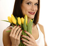 Yellow Tulips Flowers Embraced by Attractive Woman Stock Image