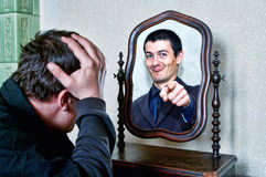 Got You!. Funny friend appears in the mirror in a successful prank Stock Image