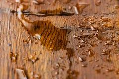 Gota da água na madeira Fotografia de Stock Royalty Free