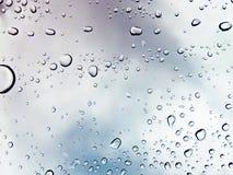 Gota da água sobre a textura de vidro fotografia de stock
