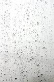 Gota de agua en un espejo Fotos de archivo