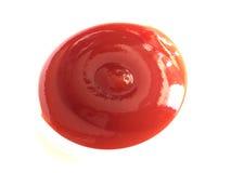 Gota de la salsa de tomate Fotos de archivo libres de regalías
