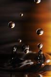 Gota del agua en líquido ondulado Imagen de archivo libre de regalías