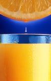 Gota do sumo de laranja. Fotografia de Stock