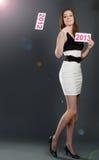 Gota hermosa de la mujer el papel con la escritura de la etiqueta 2012 Fotografía de archivo libre de regalías